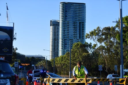Authorities cordon off a street leading to the Opal Tower at Sydney Olympic Park in Sydney on Christmas Eve.