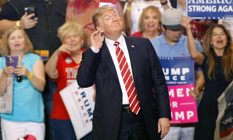 Donald Trump gestures during a rally at the Phoenix Convention Center.