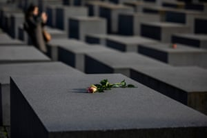 Roses are placed on the Holocaust Memorial in Berlin.