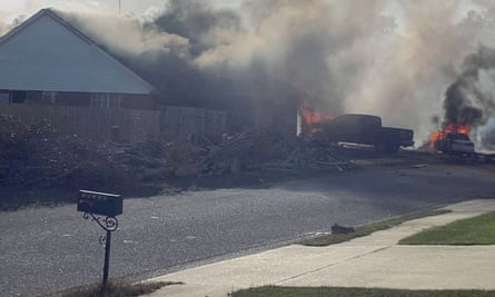 Scene of a US navy training plane crashed in an Alabama residential neighbourhood.