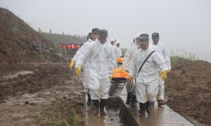 Rescuers carry victims' bodies from the capsized ship Dongfangzhixing in the Yangtze River.