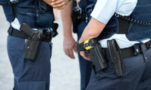 Police officers with a Taser