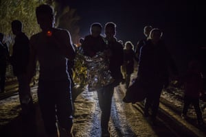 <strong>Lesbos, Greece</strong> Refugees and migrants walk across a road after arriving on a dinghy from a Turkish coast to the northeastern Greek island