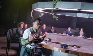 Experts in various fields share a table with actors (Natasha Gordon here) in What If Women Ruled the World? by Yael Bartana.