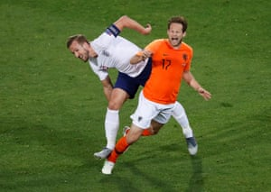 Netherlands' Daley Blind is fouled by England's Harry Kane.