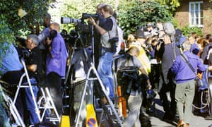 Photographers outside Paula Yates's funeral at in Faversham in 2000.