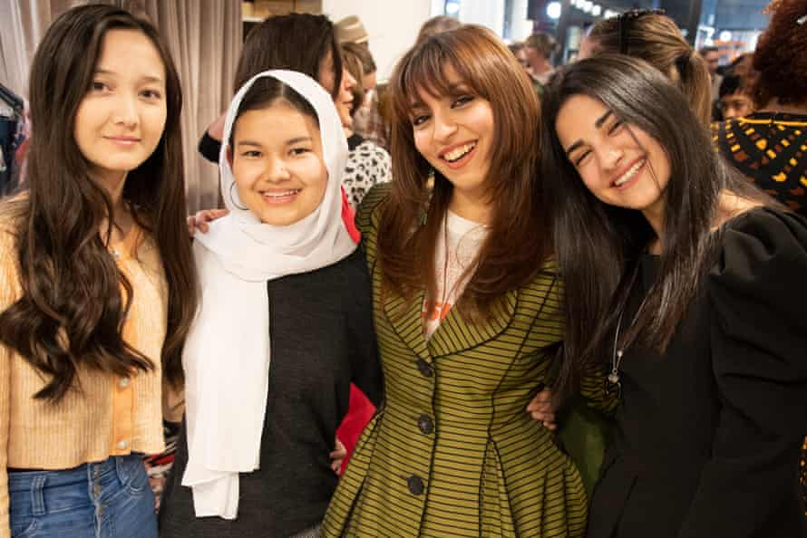 Lorrie Graham, Social Outfit retail trainer (second from right) with three Social Outfit trainees (including Shahira's younger sister Zahra, left) at their graduation ceremony in May 2021.