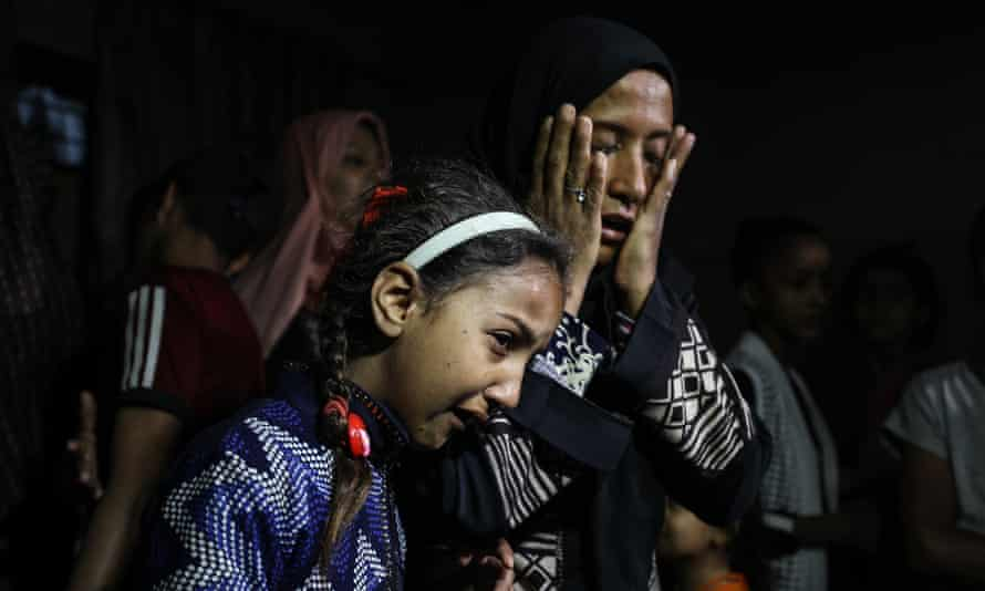 Mourners at the funeral of an eight-month-old child in Gaza City