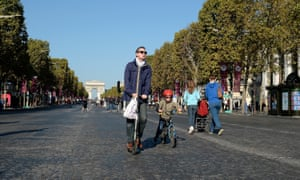 People on the Champs-Élysées during a car-free day in Paris