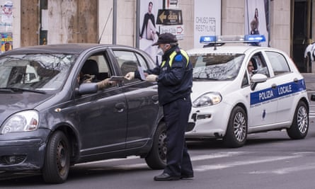 Police in Catania, Sicily, perform checks to try and contain the spread of coronavirus.