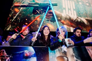 Fans engage in some lightsaber rattling as they watch stars arrive for the european premiere