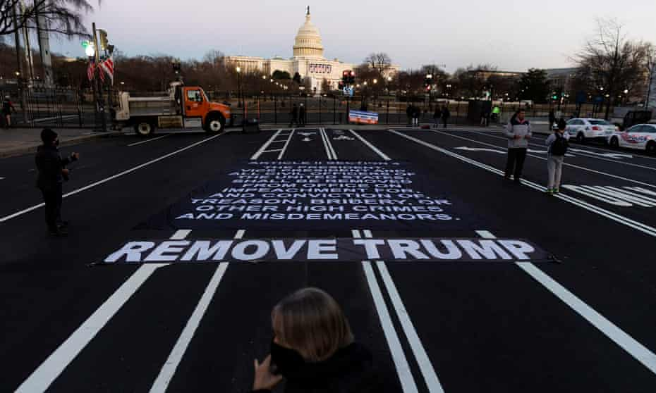 A large banner with the impeachment clause of the US constitution near the US Capitol.