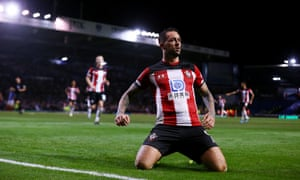 Danny Ings celebrates doubling Southampton's lead at Fratton Park.