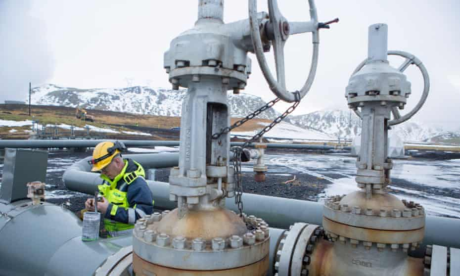 A worker on a Carbfix carbon injection well in Iceland in 201