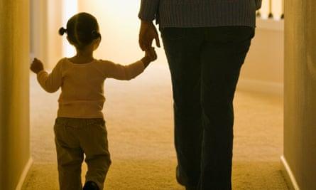 Parent and children walking hand-in-hand