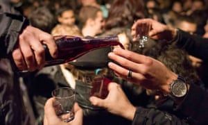 Fill me up: tasters scramble for a glass of the latest Beaujolais in the center of Lyon.