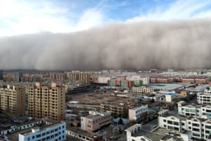 A sandstorm hits the city of Zhangye in the province of Gansu, China.