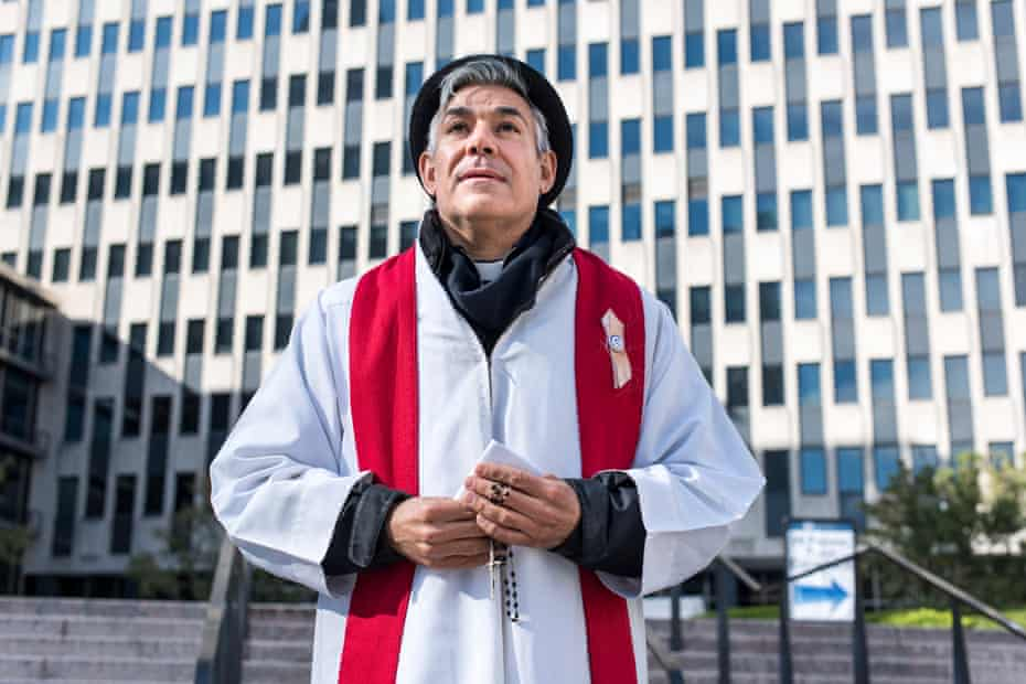 Pastor Fabian Arias of Iglesia de Sion, a Spanish-speaking congregation, leads a Jericho March outside of 26 Federal Plaza.