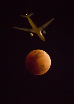 The moon passes into the earth's shadow during a lunar eclipse as seen in Hong Kong
