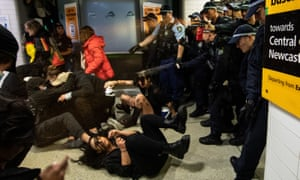 Police spraying protesters with pepper spray inside Central Station after a Black Lives Matter rally in Sydney on Saturday, June 6, 2020.
