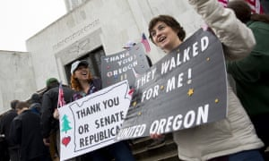 Protesters Bridgette Rappoport and Tkeisha Wydro gather outside the Oregon state house in Salem.