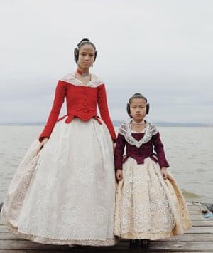 Spanish girls in fallera dresses.