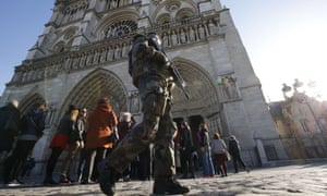 An armed security officer outside Notre Dame cathedral in Paris