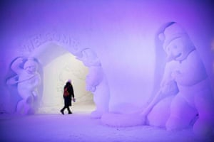 A tourist visits an ice structure at the Santa Claus Village near Rovaniemi, Finnish Lapland.