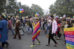 A participant wears a piece of cloth with colors of the rainbow as gay rights activists and their supporters march during a gay pride parade in New Delhi