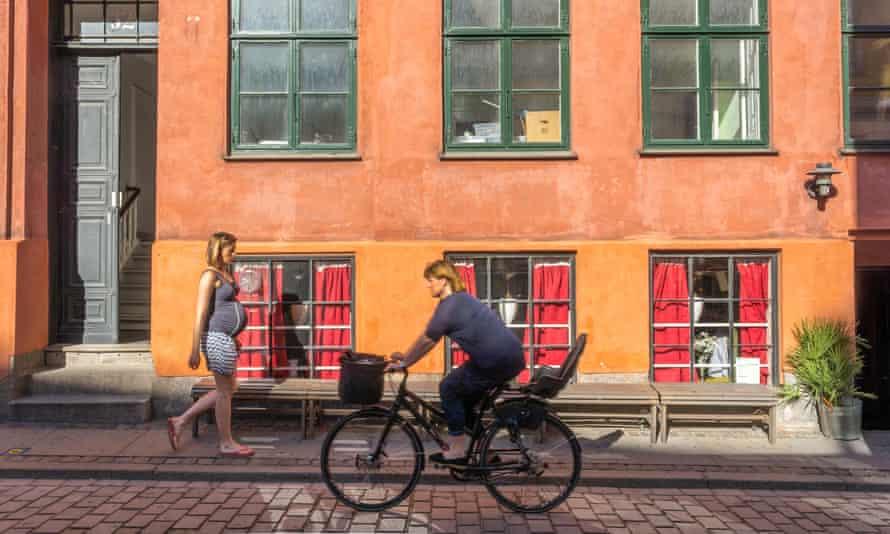Woman on a bike in Copenhagen