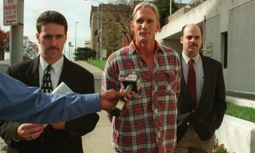 Wesley Ira Purkey, center, is escorted by police officers in Kansas City, Kansas, in 1998.