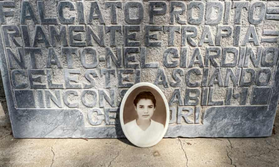 A picture of Lucia Mantione by her tombstone in Montedoro's cemetery