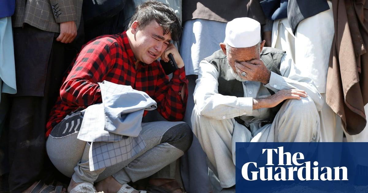 Afghan families bury schoolgirls killed in Kabul blasts – video