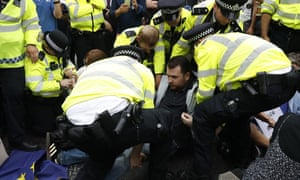 Police arrest anti-Brexit demonstrators during a sit-down protest in London in August