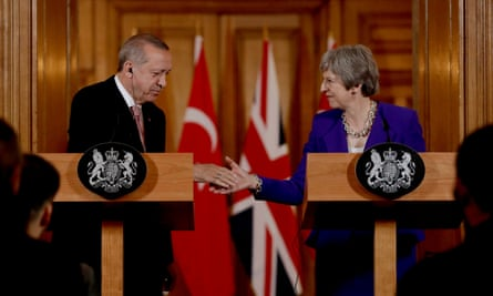 Recep Tayyip Erdoğan and Theresa May shake hands after their meeting at 10 Downing Street in London.