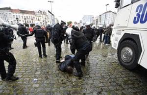Police arrest a demonstrator.