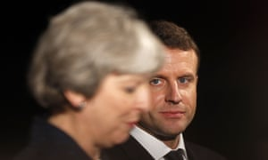 Emmanuel Macron listens to Theresa May speaking at the Victoria and Albert museum in London on Wednesday.
