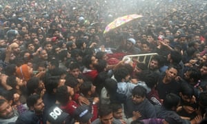 Kashmiri villagers carry Zakir Musa's body during his funeral procession at Dadsar village in Tral, south of Srinagar, on 24 May.