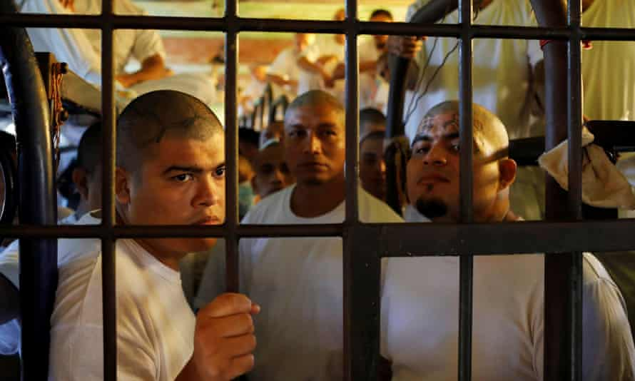 Inmates, members of the MS-13 gang, wait in their cell to be transferred from the Chalatenango penitentiary, in Chalatenango, El Salvador, on 27 December 2019.