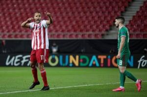 Olympiacos' Youssef El Arabi celebrates scoring their first goal.