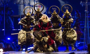 Madonna 'cast as a rebel queen sprung from jail, leading a cadre of futurist medieval samurai' at the O2.
