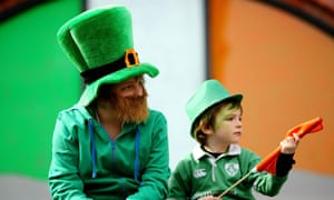People watch a previous St Patrick's day parade in Dublin.