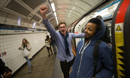 A man shouts while boarding a central line train at Oxford Circus station on the night of the launch of the 24-hour tube service.