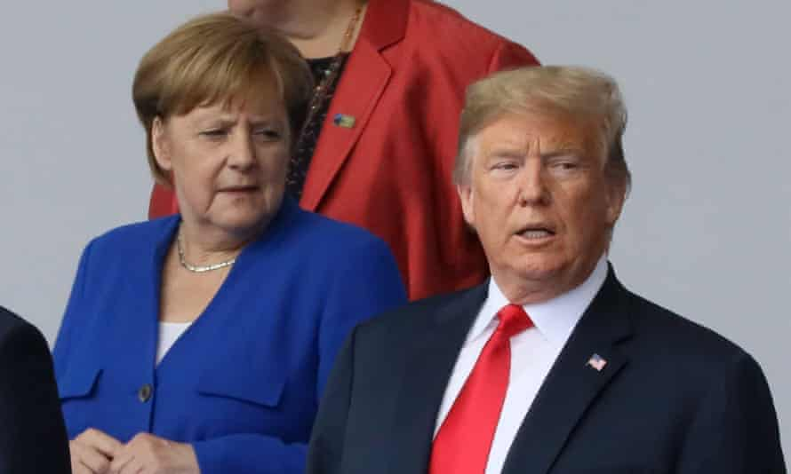 Merkel and Trump are seen as they pose for a family photo at the start of the summit.