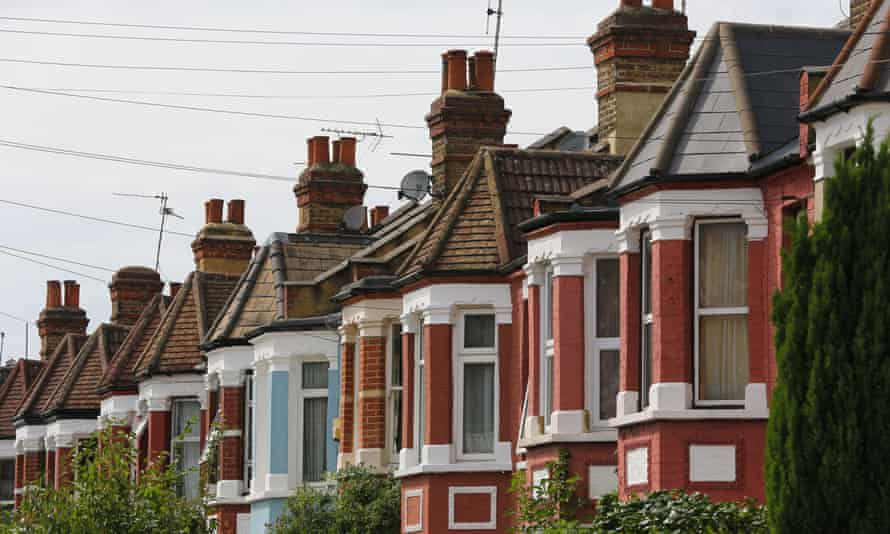 a terraced street with bay-windowed homes