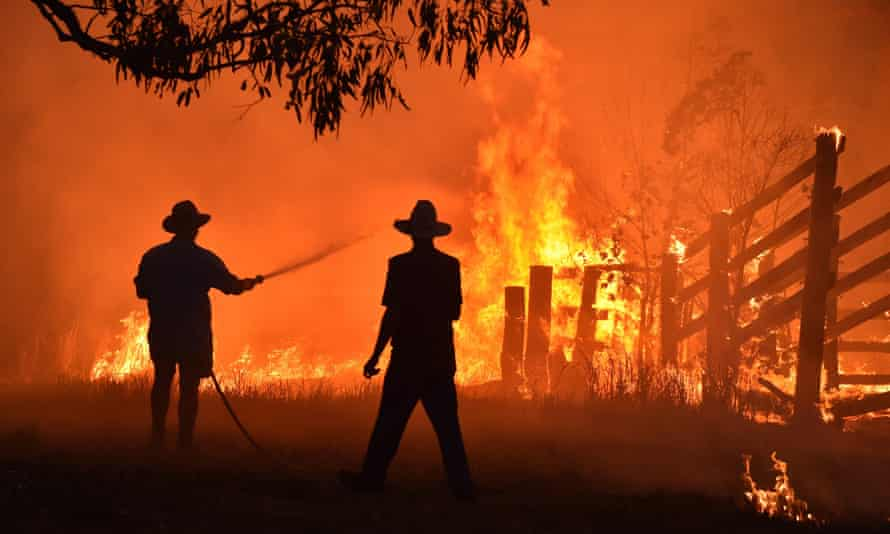 Residents defend their property from a bushfire in Hillsville, New South Wales, in November 2020