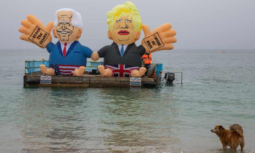 Campaigners launch a Biden and Johnson blimp on Friday morning from Gyllyngvase beach, Falmouth, calling on G7 leaders to 'crack the crisis'