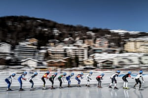 Speed skaters compete in the women's mass start 4,000m event on the St Moritz oval.
