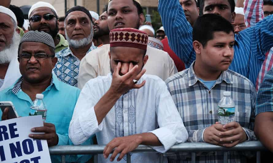 Hundreds attend a mass prayer for imam Maulama Akonjee and Thara Uddin, who died in a fatal shooting outside of a mosque in Queens.
