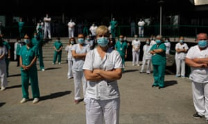 This very powerful photo shows medical officials of 12 de Octubre Hospital stand in silence for those who lost their lives due to the coronavirus pandemic, on May 8, 2020 in Madrid, Spain.
